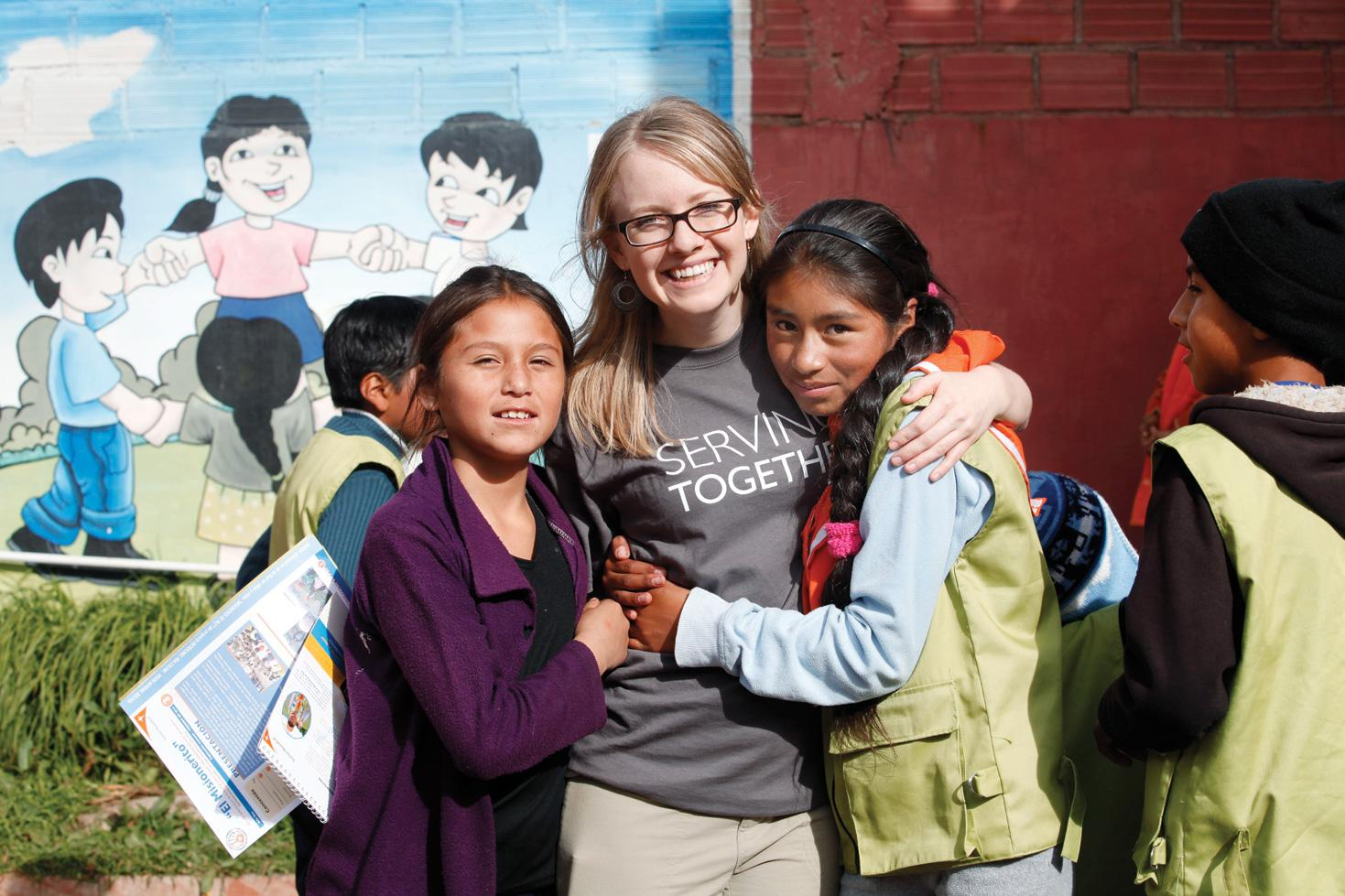 young woman visiting her sponsored children in Latin America