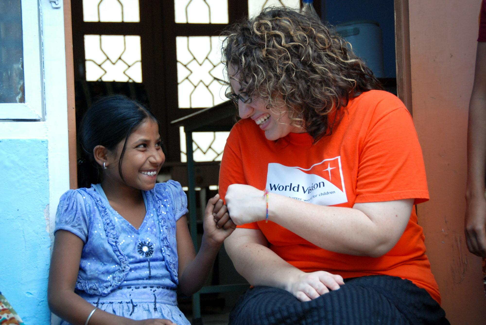 Sponsor giving a 'fist bump' to her sponsored child